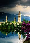 Dali's Three Pagodas of Saintly Worship reflecting in pool