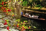 Shaoxing's East Lake in springtime with couple on boat ride