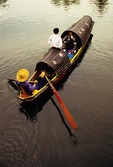 Shaoxing's East Lake foot powered boat with tourists on ride