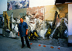 "Beijing's contemporary art scene in city's northeast Chaoyang district Discover Artist Space studio of Li Xiao Feng with the artist in front of his 4-panel painting ""Colourful Mountains & Lakes"""