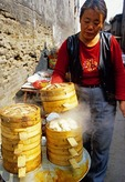Bamboo steamers to steam bread by woman street vendor in Pingyao ancient walled city