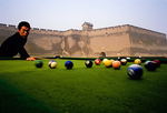 Pingyao's rammed-earth ancient wall of 2,700-year-old city, with local youth playing pool
