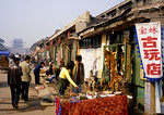 Pingyao street stalls with shoppers in the 2,700-year-old ancient walled city