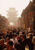 Pingyao's crowded business street in the 2,700-year-old ancient walled city with the Shi Lou (Market Building) marking the city center