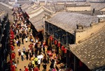Pingyao's crowded business street in the 2,700-year-old ancient walled city of Ming & Qing architecture