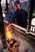 Bailin Zen Buddhist Temple pilgrims burning joss sticks.