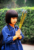 Bailin Zen Buddhist Temple, girl praying with burning joss sticks