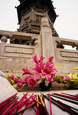 Bailin Zen Buddhist Temple, flowers and joss sticks at base of Jin dynasty pagoda