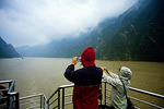 Yangtze Three Gorges, tourists on cruise ship photographing in the misty Qutang Gorge