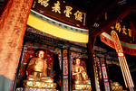 Leshan's 7th century Lingyun Temple, renovated in 17th century, golden Buddhas in the main hall