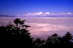 Mount Gonga, 7565 meter high, piercing the sea of clouds from summit of Emei mountain