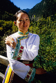 Young Tibetan woman in Jiuzhaigou valley scenic area, World Natural Heritage site