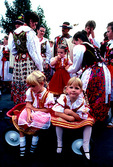 Hamtramck's summer Polish festival with participants in traditional costumes