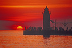 South Haven light house pier with sunset over Lake Michigan