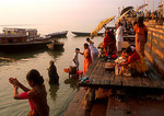 Sacred Ganges, worshippers on Varanasi ghat in morning light