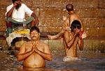 Sacred Ganges morning bathers on ghats
