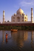 Taj Mahal with man ceremonial bathing in Yamuna River