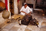 Karni Mata (Holy Rat) temple priest with rats (reincarnated Hindus)