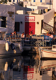 Paros outdoor taverna along inner harbor in town of Naoussa