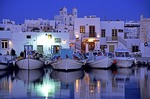 Paros fishing boats in the inner harbor of the town of Naoussa in the evening