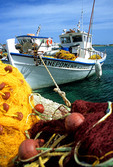 Antiparos fishing boat and nets along the harbor