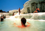 Pamukkale bathers in the thermal travertine pools