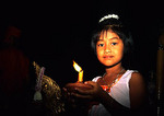 Bangkok's Rose Garden, Thai girl holding candle at ceremonial dance