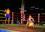 Bangkok Muay Thai, Thai kick boxers in ring prior to fight paying respects (wai) at Lumpinee Stadium