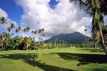 Nevis' Four Seasons Resort golf course with cloud covered Nevis Peak in background