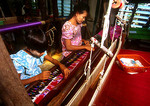 Mandalay workshop with mother and apprentice daughter weaving sarong cloth