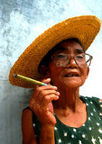 Woman smoking a cheroot
