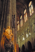Notre Dame de Paris cathedral interior with sculpture and stained glass