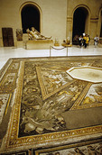 Paris Louvre Museum gallery with Roman mosaic floor