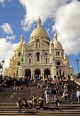 Paris Sacre Coeur Basilica front steps with tourists in Montmartre (La Basilique du Sacre Coeur de Montmartre)