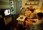 Beijing family in apartment living room watching TV