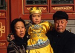 Beijing grandparents with grandchild dressed in imperial costume at the Summer Palace.