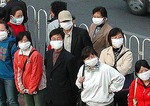 Beijing residents wearing masks for protection from dust and smog on downtown street
