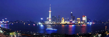 Shanghai panorama of Huangpu River and Pudong skyline at night