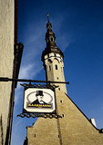 Tallinn's Town Hall tower in Old Town with shop sign