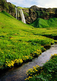 Iceland's Thorsmork Valley with waterfall and stream
