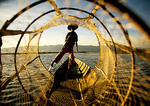 Lake Inle Intha leg rower through fishing net