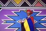 South African Ndebele woman at her shop decorated with graphic art by Esther Mahlangu near Middelberg in Mpumalanga province