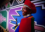 South African Ndebele woman with graphic art by Esther Mahlangu at shop near Middelberg in Mpumalanga province