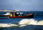 Fishing boat leaving Arniston in South Africa's Western Cape