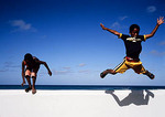 Children jumping from wall along Indian Ocean shore at Arniston in South Africa's Western Cape