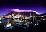 Victoria & Alfred Waterfront viewed toward Table Mountain with its table cloth cloud in Cape Town