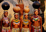 Zulu maidens carrying pots on heads at Shakaland in KwaZulu-Natal