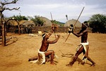 Zulu warriors demonstrate combat training at Shakaland in KwaZulu-Natal South Africa