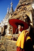 Buddhist monk at Inle Lake's Thakong Pagoda ruins