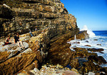 Tourists on rocks at Cape of Good Hope, most southwest point of African continent